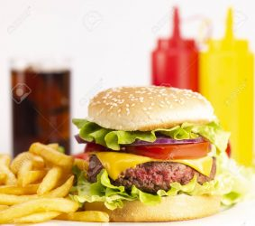 Burger with French fries cutlet with cheese and tomato, France